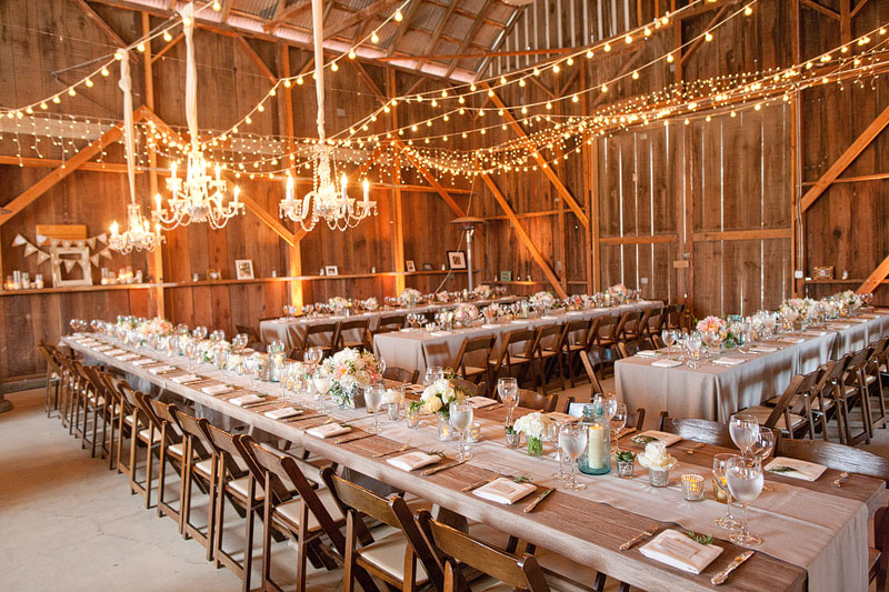 indoor or outdoor wedding reception with long tables and twinkle lights